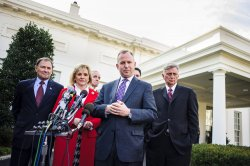 A bipartisan delegation of governors speaks to the media outside the White House in Washington