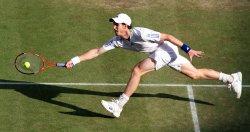 Andy Murray returns at Wimbledon.