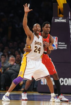 Kobe Bryant calls for the ball against Blazers' Webster in Los Angeles