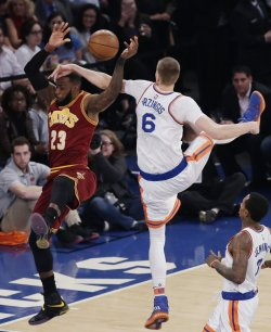Cavaliers LeBron James is foulded by Knicks Kristaps Porzingis