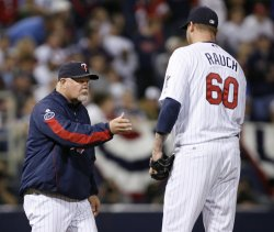 Twins manager Gardenhire takes out pitcher Rauch during game 3 of the ALDS in Minneapolis
