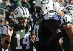 New York Jets Ryan Fitzpatrick applauds in the huddle
