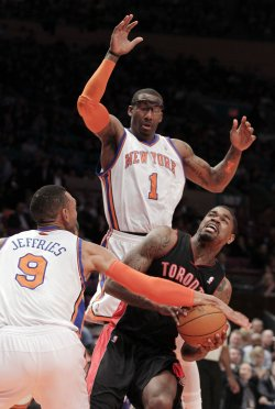 New York Knicks Amar'e Stoudemire and Jared Jeffries play defense on Toronto Raptors Amir Johnson at Madison Square Garden in New York