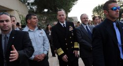 Chairman of the U.S. Joint Chiefs of Staff, Admiral Michael Mullen walks behind security guards at the Yad Vashem Holocaust Museum in Jerusalem