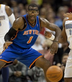 Knicks Stoudemire Watches Errant Pass Slip Past at the Pepsi Center in Denver