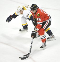 Predators Smith tries to steal puck from Blackhawks Stalberg in Chicago