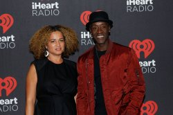 Bridgid Coulter and Don Cheadle arrive for the iHeartRadio Music Festival