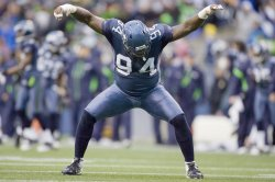 Seattle Seahawks defensive Anthony Hargrove celebrates his sack on Washington Redskins quarterback Rex Grossmanat in Seattle.