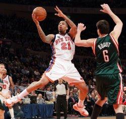 Milwaukee Bucks Andrew Bogut (6) plays defense as New York Knicks Wilson Chandler drives to the basket at Madison Square Garden