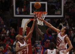 Pistons' Brown shoots as Bulls' Gibson and Noah defend in Chicago
