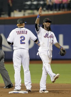 New York Mets Jose Reyes and Justin Turner react after the game at Citi Field in New York