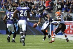 Baltimore Ravens' Domonique Foxworth intercepts a pass against the Cleveland Browns in Baltimore