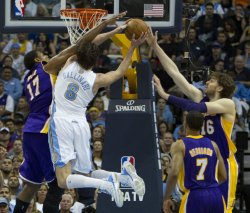 Lakers Bynum and Gasol Stop Nuggets Gallinari During the NBA Western Conference Playoffs First Round Game Three in Denver