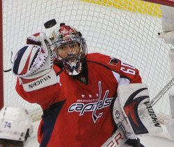 Capitals goalie Theodore catches a shot by the Canadiens in Washington
