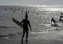 Mavericks Invitational big surf paddle out at Princeton-by-the-Sea, California