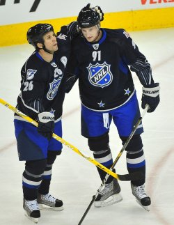 Martin St. Louis celebrates with teammate Steven Stamkos during the 2011 NHL All-Star Game