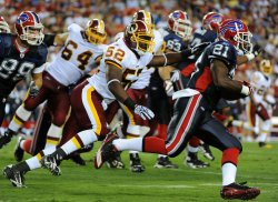Buffalo Bills' running back C.J. Spiller runs for a gain in Washington
