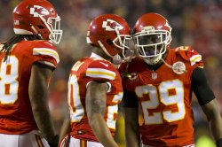 Kansas City Chiefs Eric Berry celebrates a tackle with Steven Nelson and Vernon Harris in Kansas City