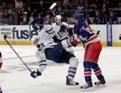 New York Rangers Steve Eminger hits Toronto Maple Leafs Nikolai Kulemin at Madison Square Garden in New York