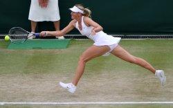 Maria Sharapova returns at Wimbledon.