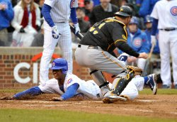 Cubs Castro scores past Pirates Doumit in Chicago