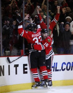 Blackhawks Byfuglien and Ladd celebrate game-winning goal against the Rangers in Chicago
