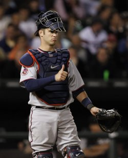 Twins Mauer stands on field against White Sox in Chicago