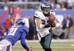 New York Giants Kenny Phillips defends Philadelphia Eagles Brent Celek who catches a 65 yard touchdown at New Meadowlands Stadium in New Jersey
