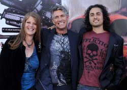 "Eric Roberts arrives with his wife Eliza Roberts and stepson Keaton Simmons at ""The Expendables"" premiere in Los Angeles"