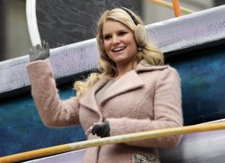 Jessica Simpson rides down the parade route on a float at the Macy's 84th Annual Thanksgiving Day Parade in New York