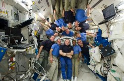 NASA STS-131 and Space Station Expedition 23 crew members pose for a photo