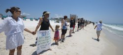 Florida Governor Charlie Crist takes part in Hands Across the Sand in Pensacola