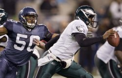 Seattle Seahawks linebacker K.J. Wright, left, sacks Philadelphia Eagles quarterback Vince Young in the fourth quarter .