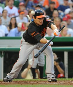 Orioles Hernandez attempts to bunt against Nationals in Washington
