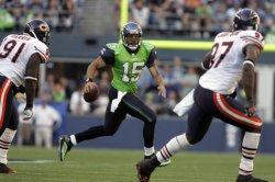 Seattle Seahawks quarterback Seneca Wallace scrambles