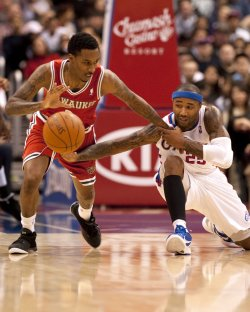 Milwaukee Bucks' Brandon Jennings steals the ball from Los Angeles Clippers' Mo Williams in Los Angeles