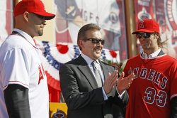 Los Angeles Angels' Albert Pujols, owner Arte Moreno, and pitcher C.J Wilson as they are introduced to the media during a news conference in Anaheim, California