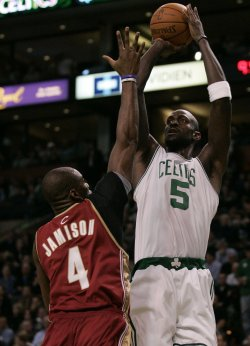 Celtics Garnett gets off shot against Cavaliers Jamison in Boston, MA.