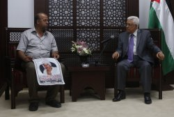 Palestinian President Mahmoud Abbas meets beaten teen in Ramallah