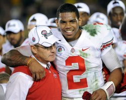 Ohio State quarterback Terrelle Pryor (R) hugs head coach Jim Tressel Rose Bowl in Pasadena, California