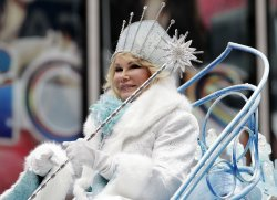 Joan Rivers rides down the parade route on a float at the Macy's 84th Annual Thanksgiving Day Parade in New York