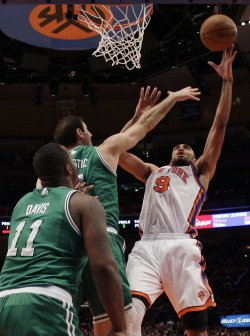 Boston Celtics Nenad Krstic tries to block a shot from New York Knicks Jared Jeffries at Madison Square Garden in New York