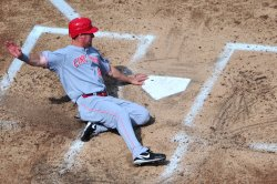 Reds Ryan Ludwick slides into home in Washington