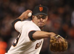 Giants Javier Lopez throws in relief against the Dodgers in San Francisco
