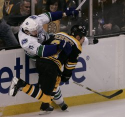 Bruins Ference checks Canucks Kesler in game 6 of the NHL Stanley Cup Finals in Boston, MA.