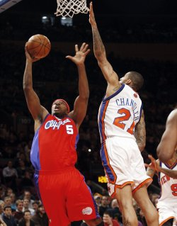 New York Knicks Wilson Chandler tries to block a shot from Los Angles Clippers Craig Smith in the first half at Madison Square Garden in New York