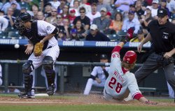 Phillies Werth Scores Against the Rockies Iannetta in Denver
