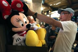 Chinese tourists shop for souvenirs in Shanghai Disneyland, China