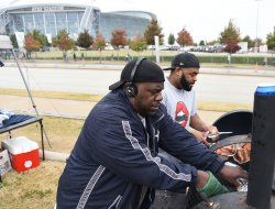 NFL fans tailgate on Thanksgiving Day at AT&T Stadium