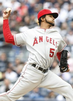 Los Angeles Angels of Anaheim starting pitcher Ervin Santana throws a pitch in the third inning against the New York Yankees on opening day at Yankee Stadium in New York